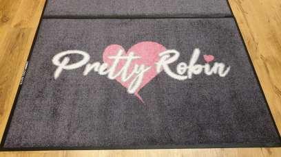 Pretty Robin logo mat 1