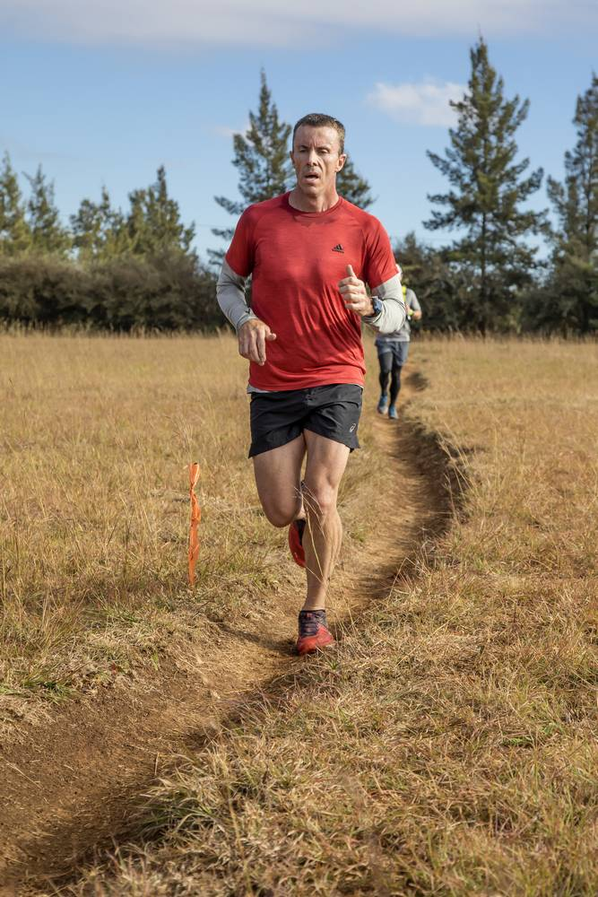 Trail runner on single track_sport and action photography
