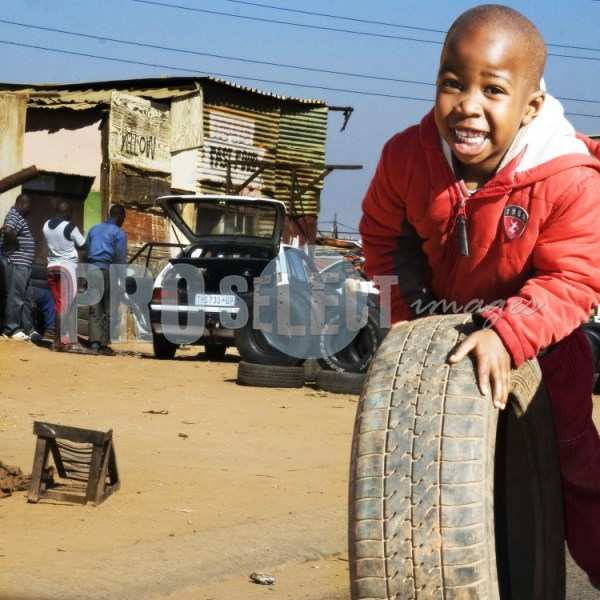 Township kid rolling tyre | ProSelect-images
