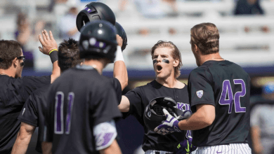 Chris Baker celebrates with  teammates after his grand slam Sunday versus the UCLA Bruins at Husky Ballpark. (Stephen Brashear)