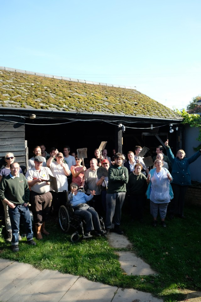 Photo of Co-workers outside the Hovel before the renovation work
