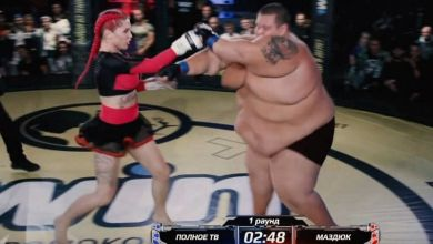 Photo of 139 Pound Woman Fights 529 Pound Man in MMA fight … and Whoops His Ass.