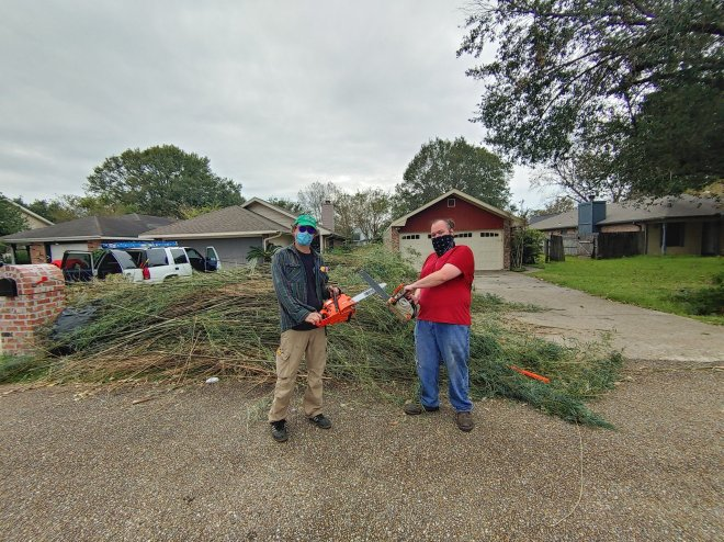 Organizers prepare to clear storm damage.