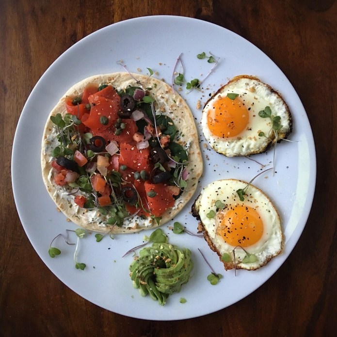 Salmon Flatbread, with Two Sunny Side Up Eggs, and Avocado Rose