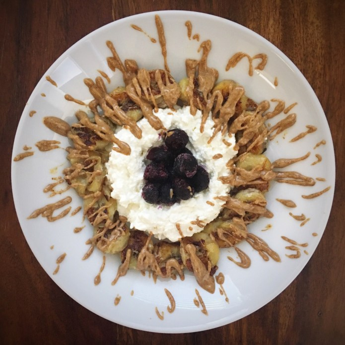 Almond Nut Butter Drizzle Over Sautéed Bananas and Cottage Cheese, with Frozen Blueberries