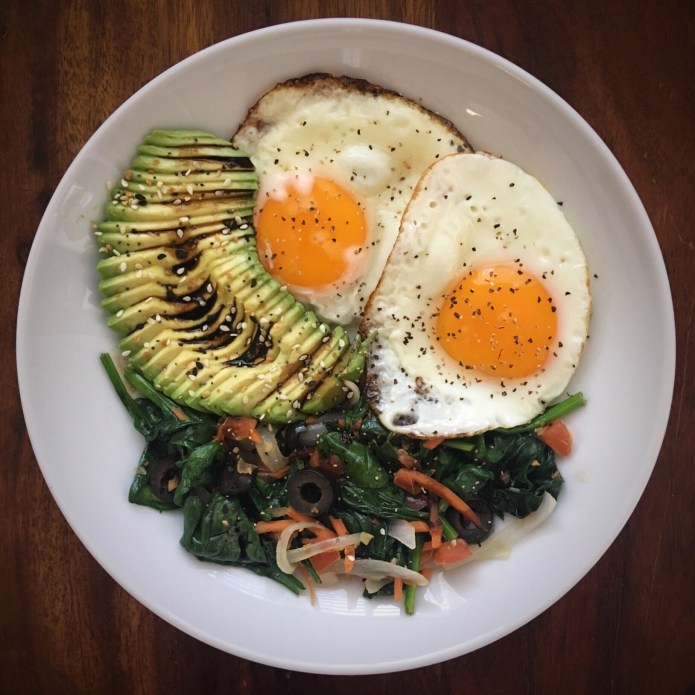 Balsamic Reduction over Sliced Avocado, with Eggs, Spinach, Carrots, Onions, and Olives