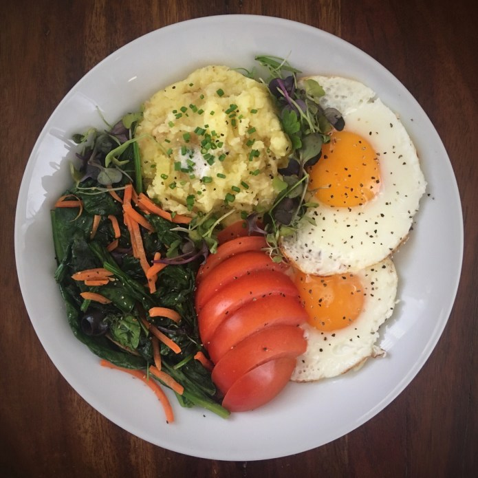 Breakfast Mashed Potatoes, with Eggs, Tomato, and Sautéed Spinach Salad with Carrots, Olives, and Microgreens