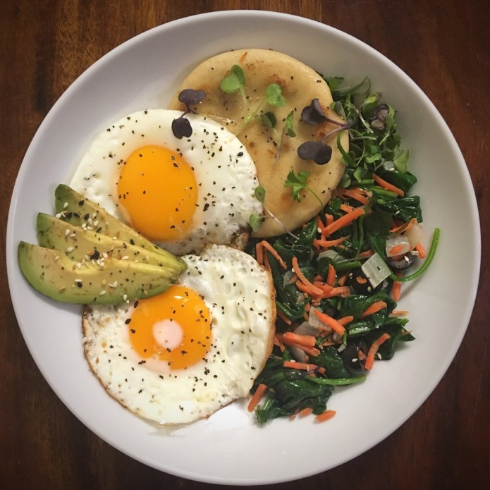 Papusa, Eggs, and Avocado, with a Sautéed Spinach Salad of Carrots, Onions, Olives, and Microgreens