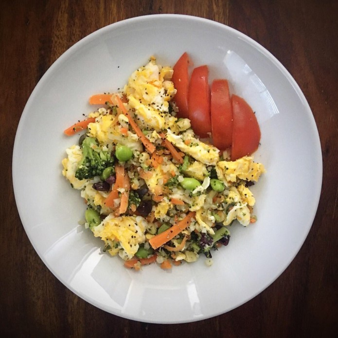 Breakfast Scramble with Cauliflower Rice, Edamame, Corn, Carrots, and Broccoli, Side of Tomatoes