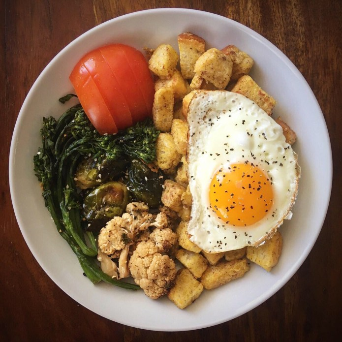 French Toast Bites with Fried Egg, and a Side of Cauliflower, Brussels Sprouts, Broccolini, and Tomato