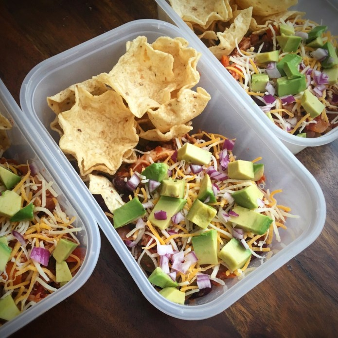 Chili To Go, topped with Shredded Cheese, Red Onion, Avocado; served with a side of Corn Chips