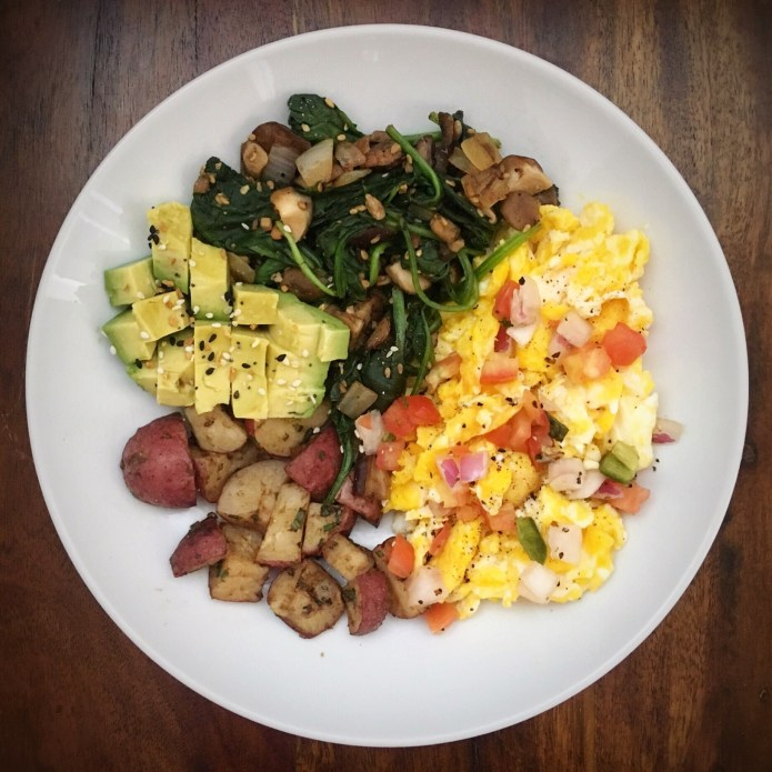 Scrambled Eggs, Topped with Pico de Gallo, Side of Potatoes, Cubed Avocado, and a Spinach-Mushroom-Garlic-Onion Sauté