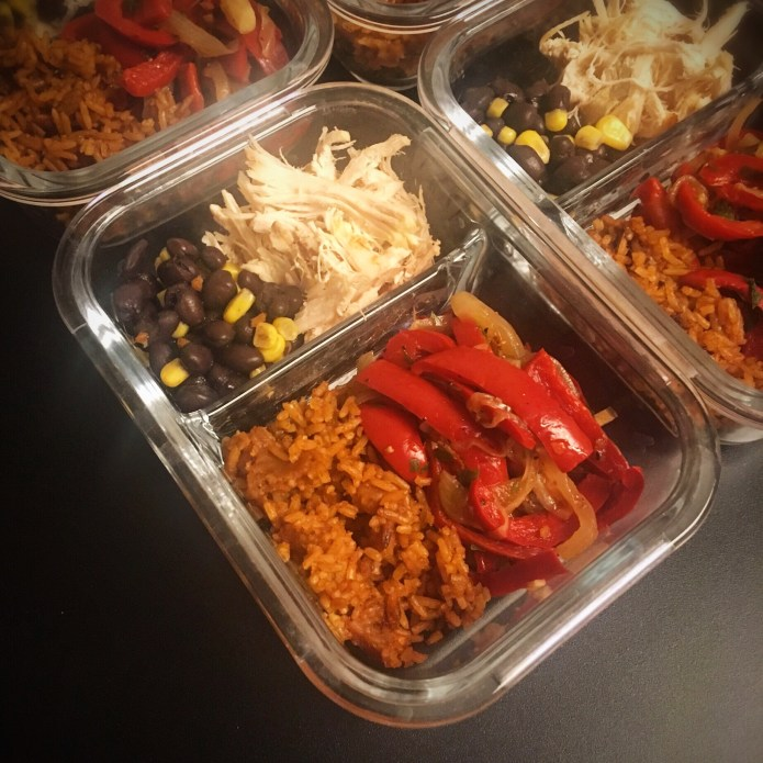 Fajita Burrito Bowl Meal Preps with Peppers and Onions, Spanish Rice, Shredded Chicken and Black Beans with Corn