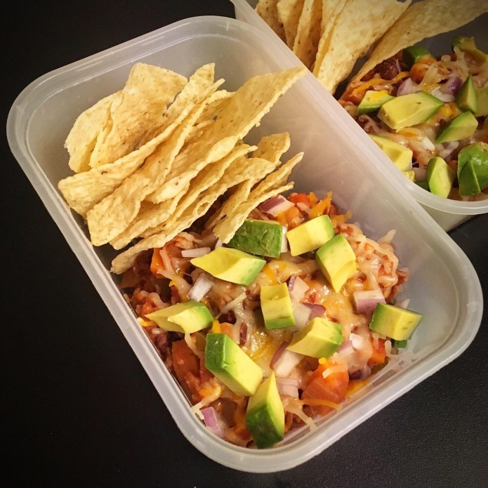 Chili topped with Cheese, Red Onion, and Avocado, with a Side of Corn Chips (To Go)