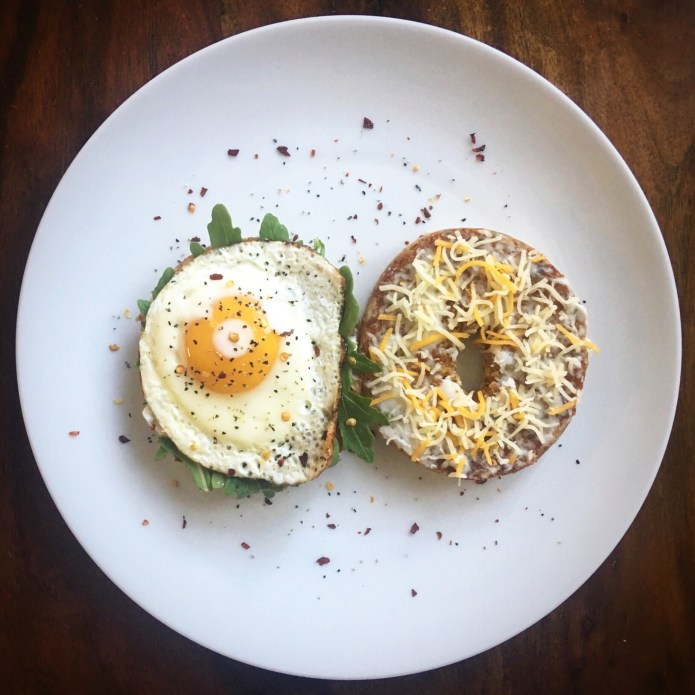 Arugula Salad on Bagel with Cream Cheese with Fried Egg