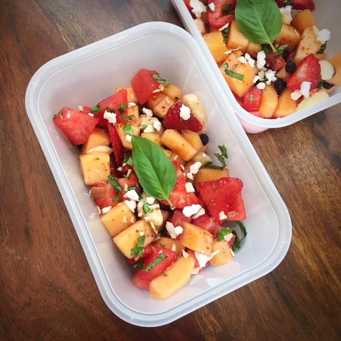 Fruit Salad with Cantaloupe, Watermelon, Banana, Strawberries, Blueberries, Vegan Feta, Slivered Almonds, Mint, and Basil
