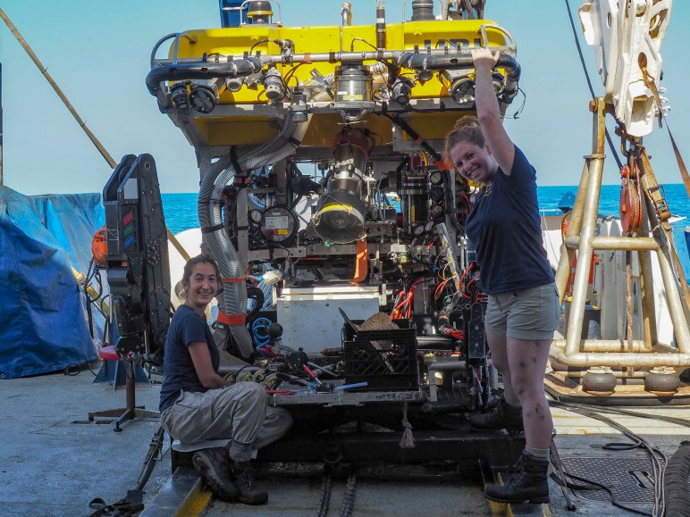 Jess and Antonella prepare Hercules for his next dive to an underwater volcano off the coast of Hawai'i. Image Credit: Jenny Woodman