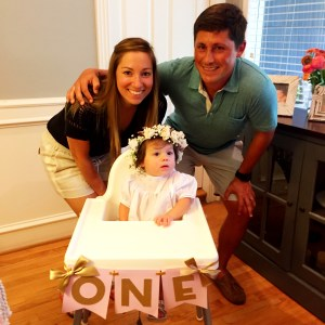 Here's Ashley with her husband, Peyton, on their adorable daughter, Margaret 's first birthday