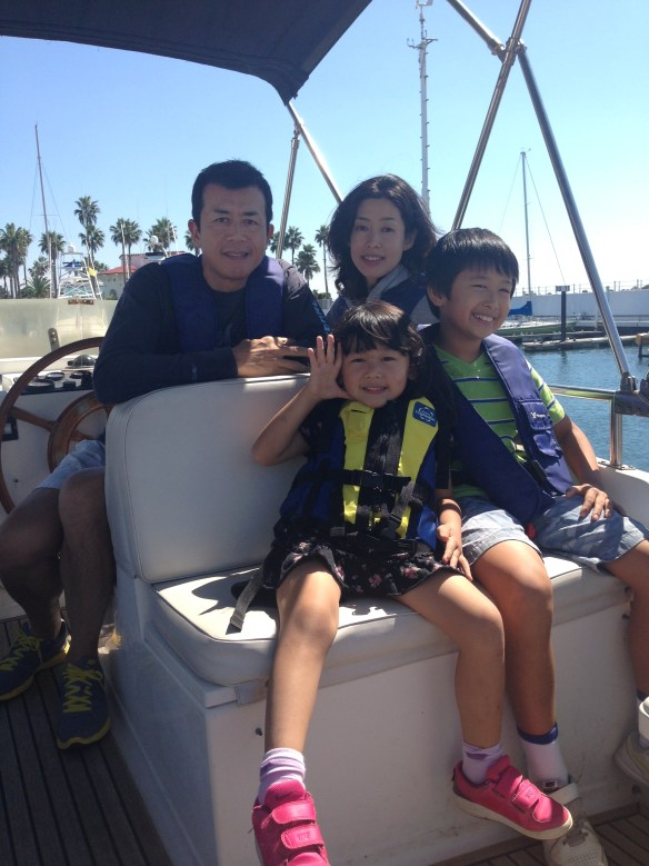 Pictured above is Tomoko with her husband Kaz, her son Taiyo, and her daughter Lina during a weekend boat trip
