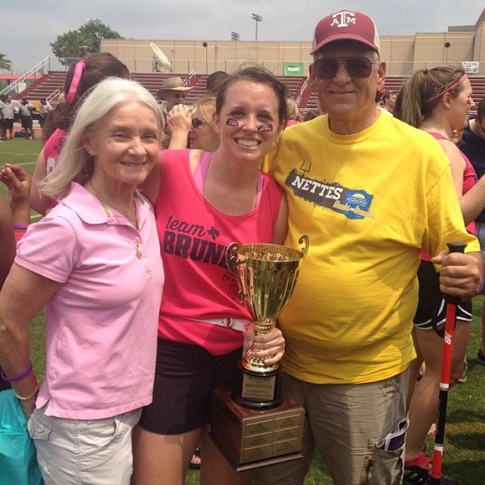 Casey Jo with her parents and the Brunette Championship trophy (2014)