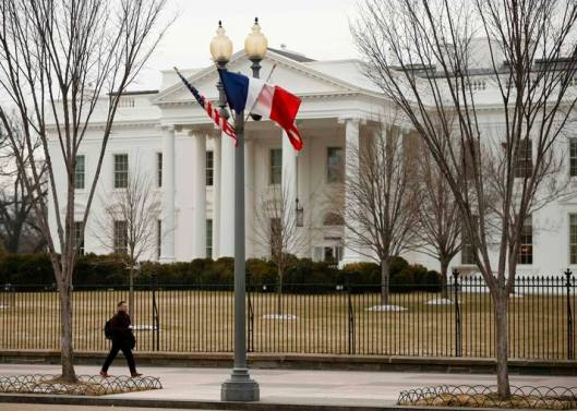 U.S. and French flags in front of the White House to honor French President Hollande in Washington