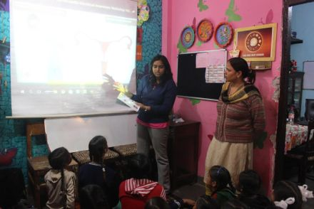 Sakshi (Volunteer) explaining the cycle of Menstruation.