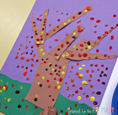 Fall tree art using torn construction paper, Q-tips, and paint by Proud to be Primary.