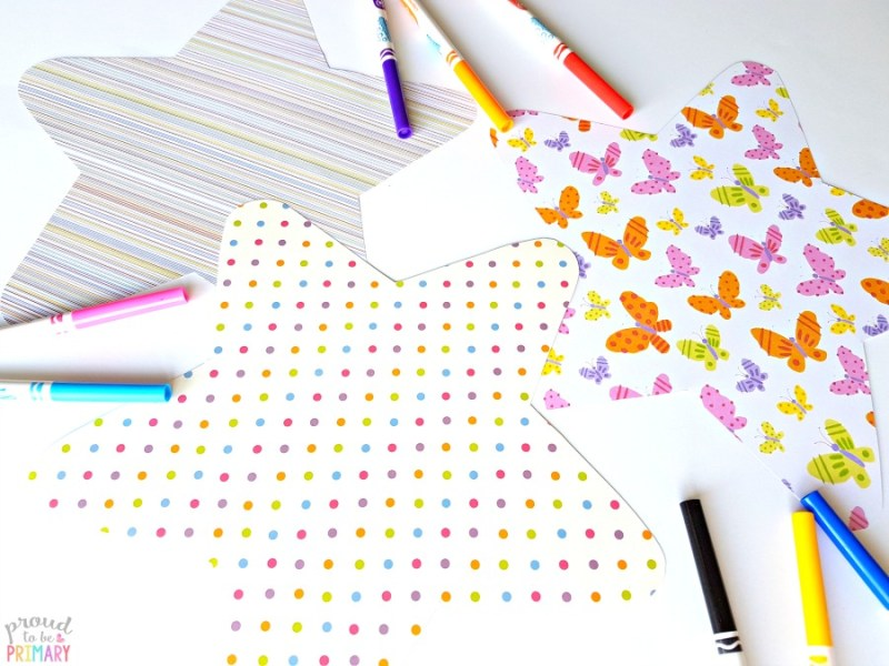 scrapbook stars cut out on table with markers