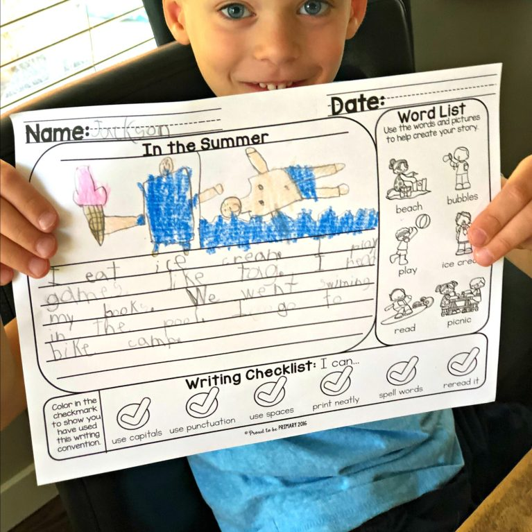 child holding up writing prompt activity