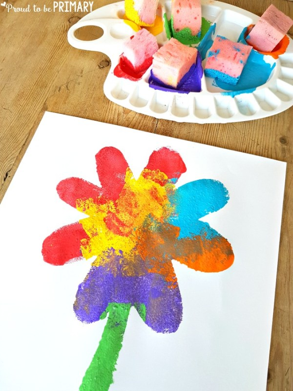 flower spring sponge art on wooden table with paint