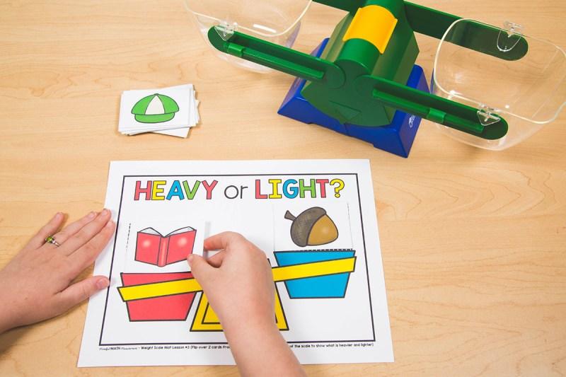 kindergarten measuring heavy or light objects