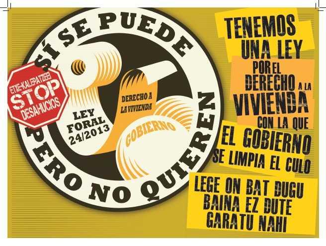 cartel en Navarra de denuncia pisos públicos vacíos.
