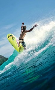 anonymous male surfer riding wave in sea