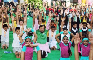 The Union Minister for Human Resource Development, Prakash Javadekar performing Yoga with the Students from 25 States participating in the final round of Yoga Olympiad, in New Delhi on June 19, 2017.