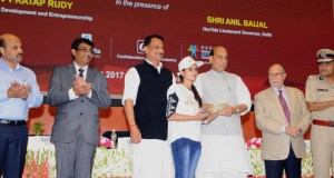 """The Union Home Minister, Rajnath Singh distributing the kit to youth after inaugurating the training centre under """"Yuva - Skill Development Programme"""" by the Delhi Police, in New Delhi on August 29, 2017.  The Minister of State for Skill Development & Entrepreneurship (Independent Charge),  Rajiv Pratap Rudy, the Lt. Governor of Delhi, Shri Anil Baijal and the Commissioner of Police, Delhi, Amulya Patnaik are also seen."""
