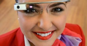 Seen in the picture is a Virgin Atlantic air hostess with google glasses on to serve its tech savvy clientele. Virgin Atlantic Crew is renowned for best service standards in the Aviation Industry.