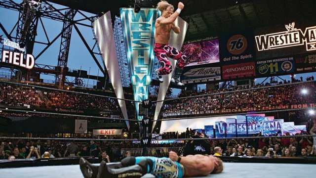 Shawn Michaels mid-flight against Chris Jericho at WrestleMania 19