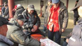 Ancianos jugando a las cartas