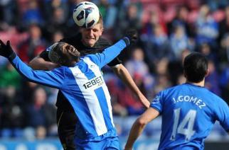 El 'Spanish' Wigan sale del descenso gracias a Koné