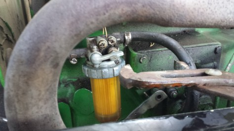 Loosening fuel filter John Deere 950 - Poudre River Stables - Fort Collins - Colorado - 80521