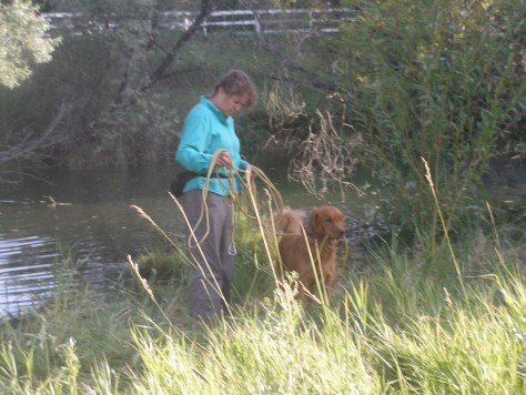 """Me untangling the long leash before we start. Watson still likes to carry the leash. A bad habit in other dogs, he uses it like a rein to help """"stay in touch""""."""