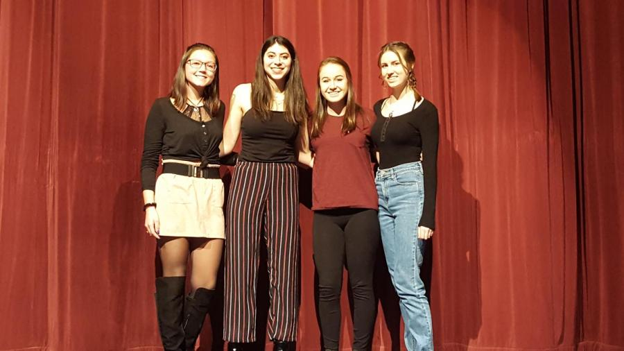 The+winners+of+the+Creative+Writing+poetry+slam+pose+for+a+picture.+From+left+to+right%3A+Isabelle+Myers%2C+Justine+Golata%2C+Katie+Svehla%2C+Abbey+Connolly