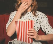 happily-ever-after-chick-flick-woman-at-movie-eating-popcorn