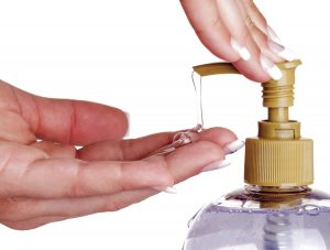 triclosan-handsoap-bottle-woman-hands-pump