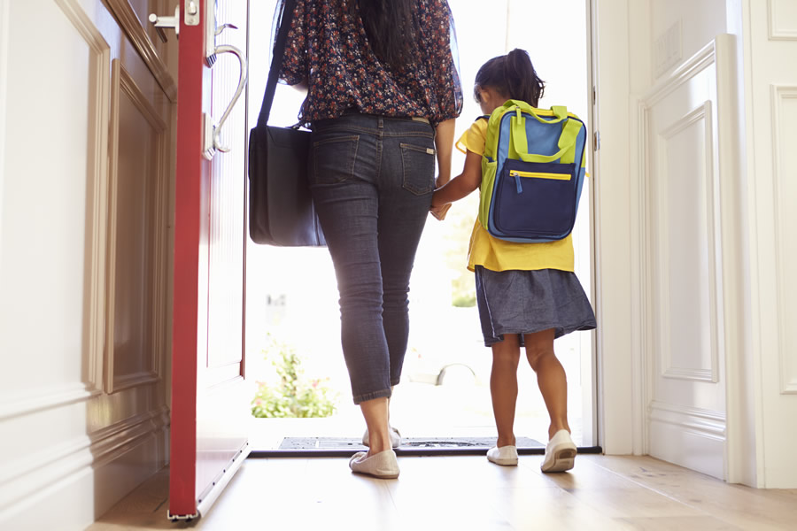 Empty Nest - mother-with-young-child-leaving-for-school-with-red-door