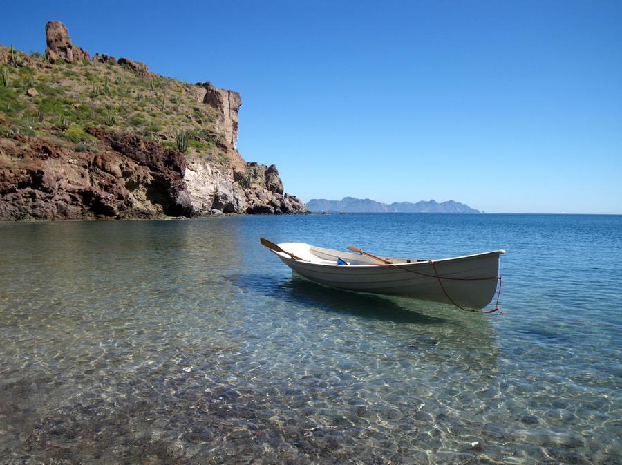 expat-row-boat-anchored-at-shoreline