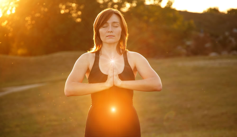 looking-good-woman-meditating-with-energy-center