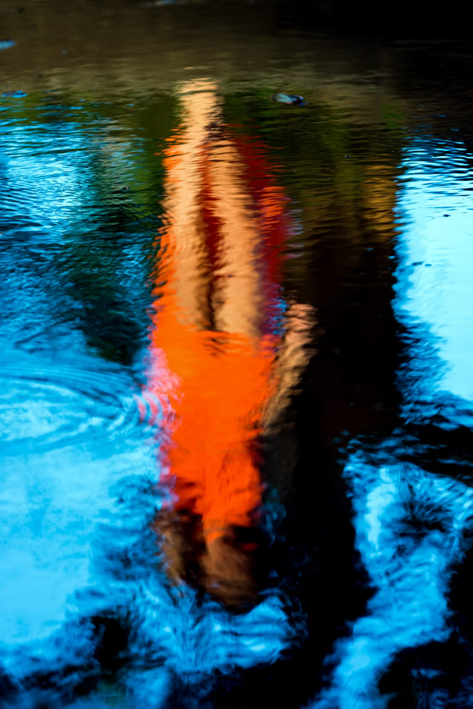 looking-good-woman-reflection-in-pond