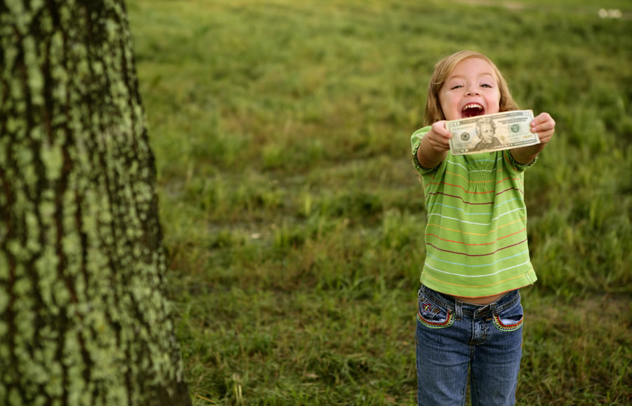 money-stories-happy-little-girl-with-dollar-note-in-hands