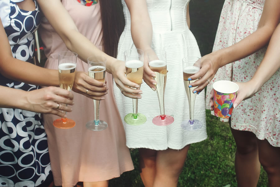 moving-hands-of-woman-holding-colorful-glasses-and-toasting-champagne-at-joyful-party-in-summer-park